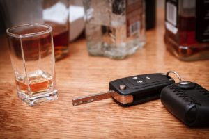Alcohol and car key on the table