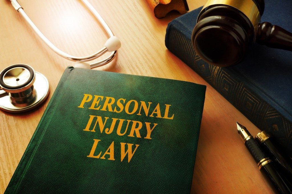 Personal injury law book on a table.
