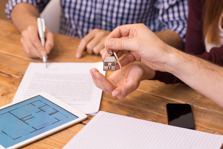Man signing a property contract