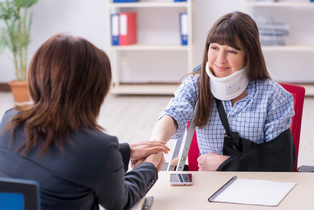 Injured client consulting a lawyer
