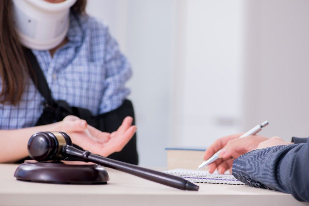 Client consulting an injury lawyer