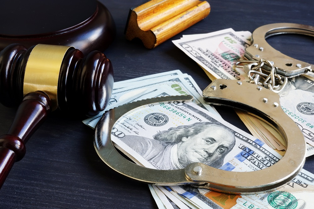 dollars with gavel and handcuffs