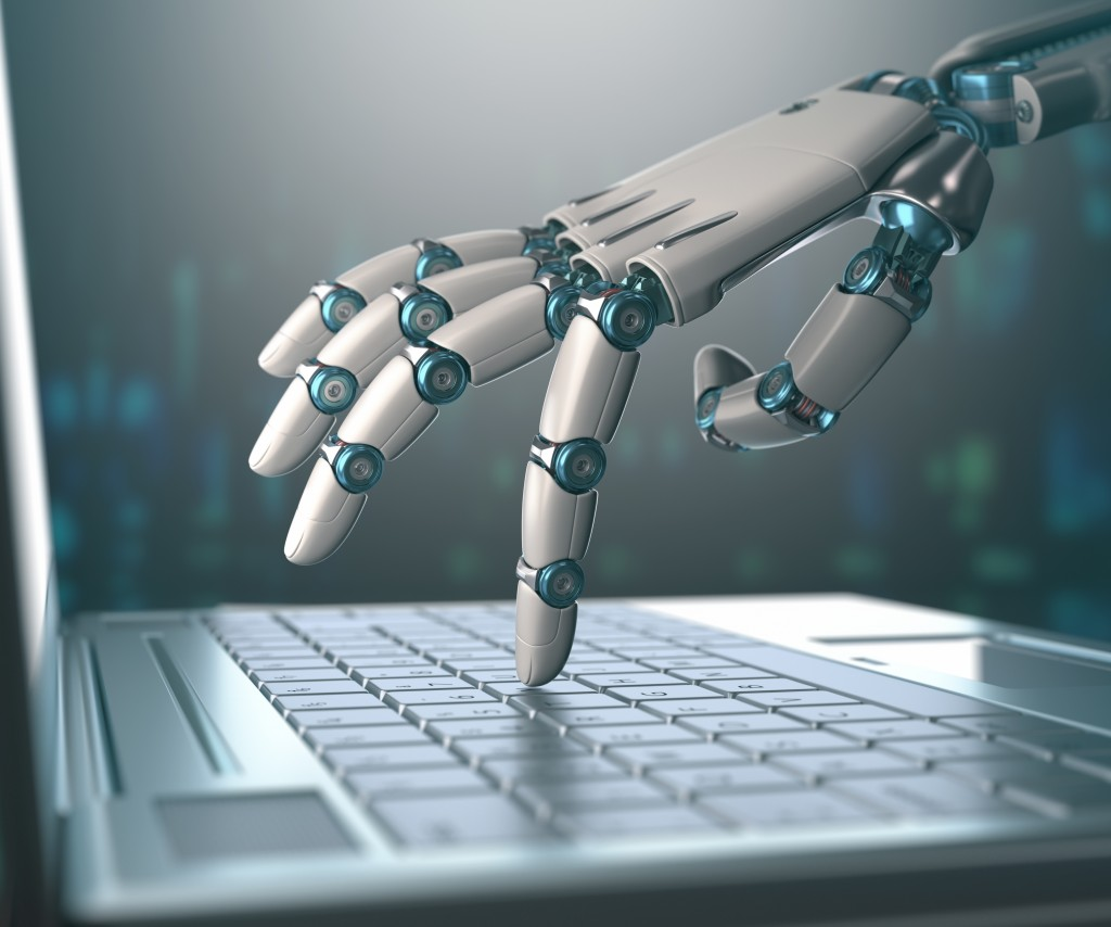 Robotic hand, accessing on laptop, the virtual world of information