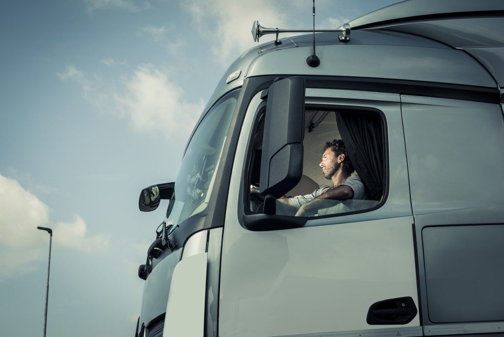 A truck driver in his truck