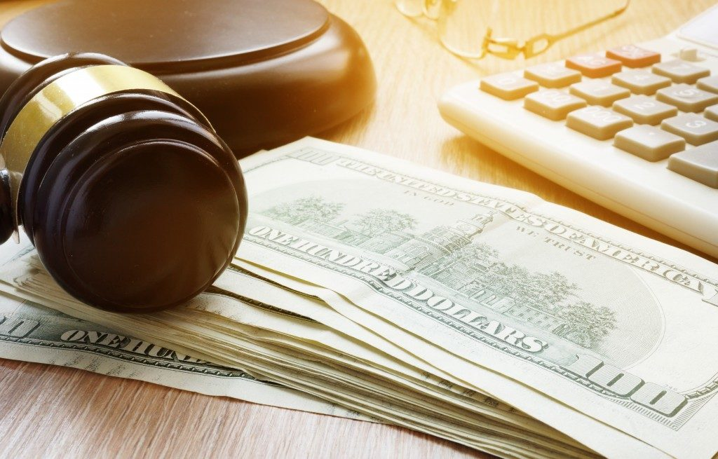 US dollars and a wooden gavel