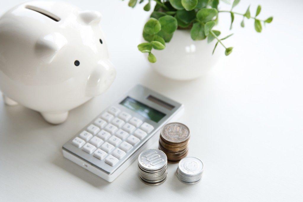 piggy bank, calculator, and money