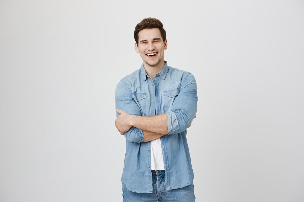 man wearing light denim polo and pants