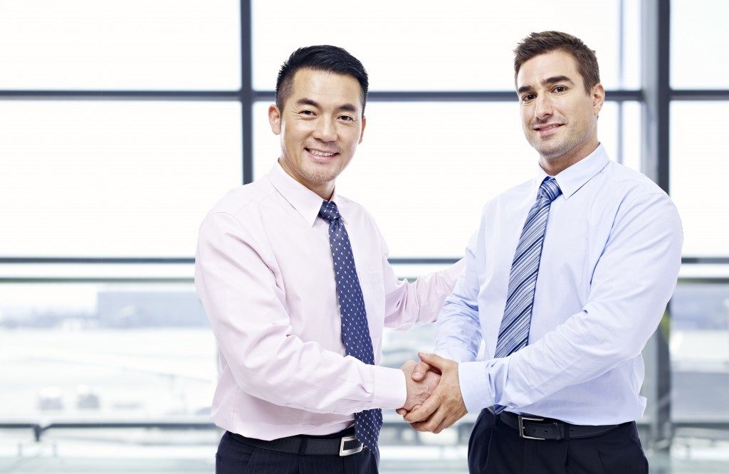 Asian and caucasian businessmen shaking hands