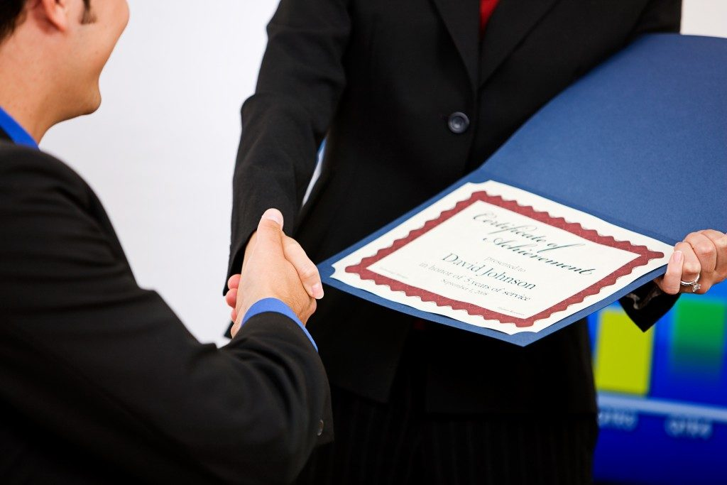 Employee Gets A Certificate Of Achievement