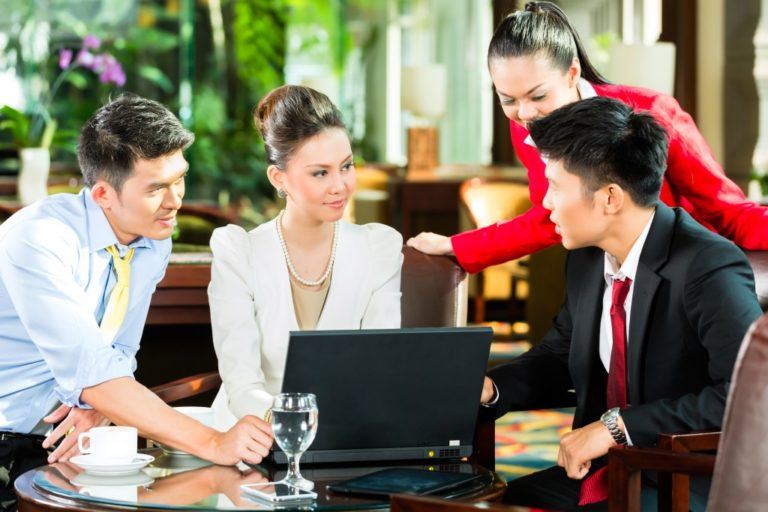 Asian business people talking