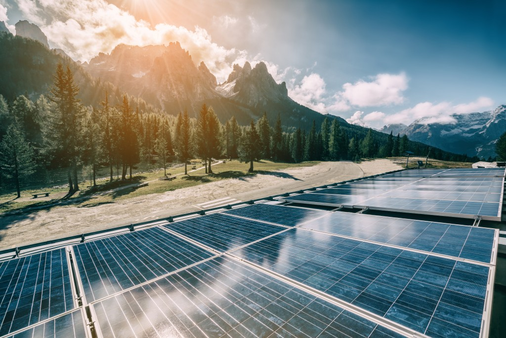Solar powerplant surrounded by mountains