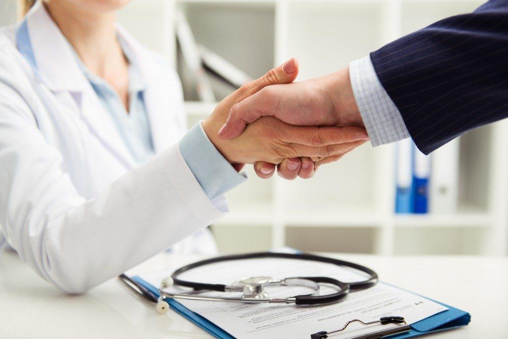Doctor and businessman handshake