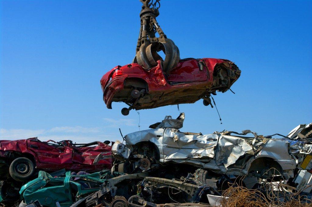 scrapped car in a junk yard