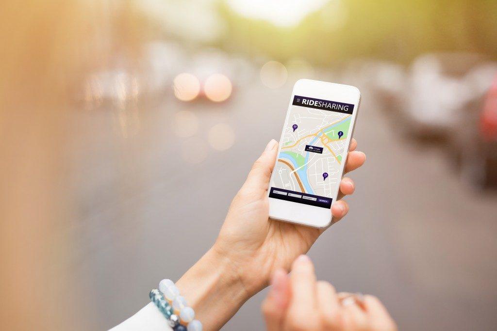 woman looking at a ride sharing app