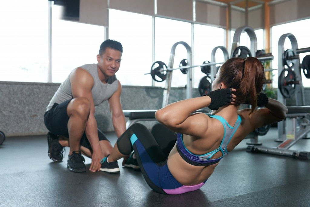 woman working with a personal trainer