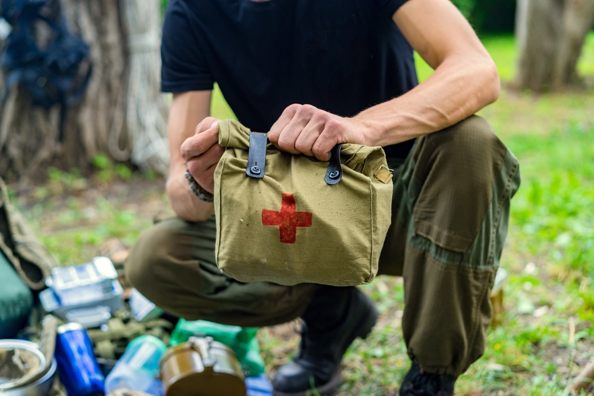 Man carrying a first aid kit