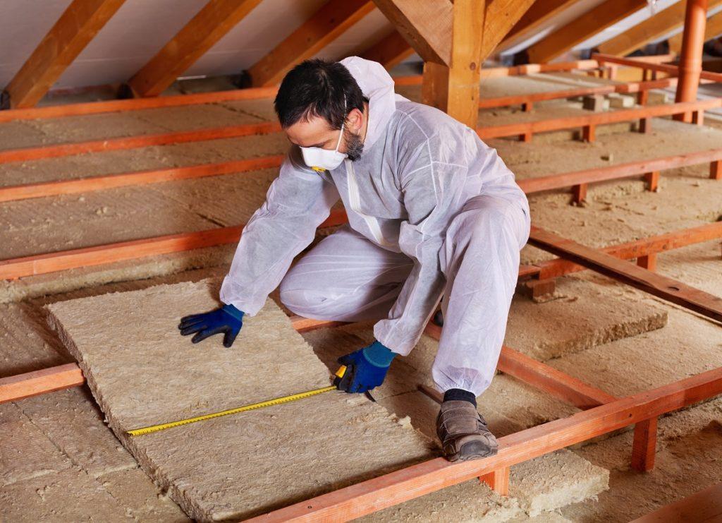Man insulating the attic