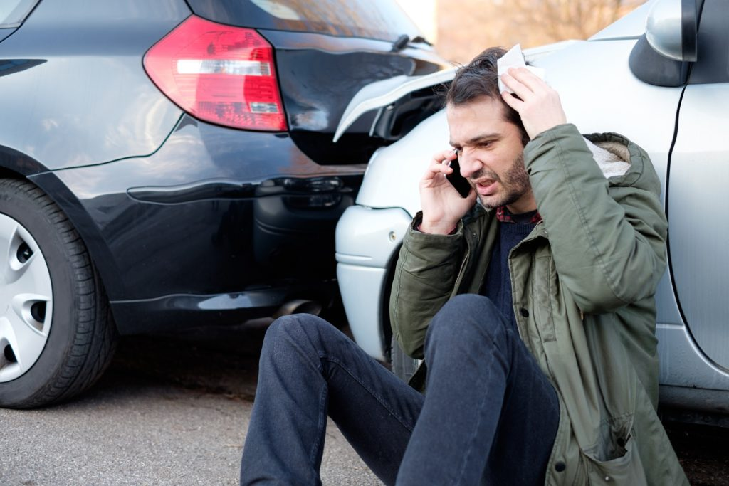 man calling his attorney or lawyer after an incident