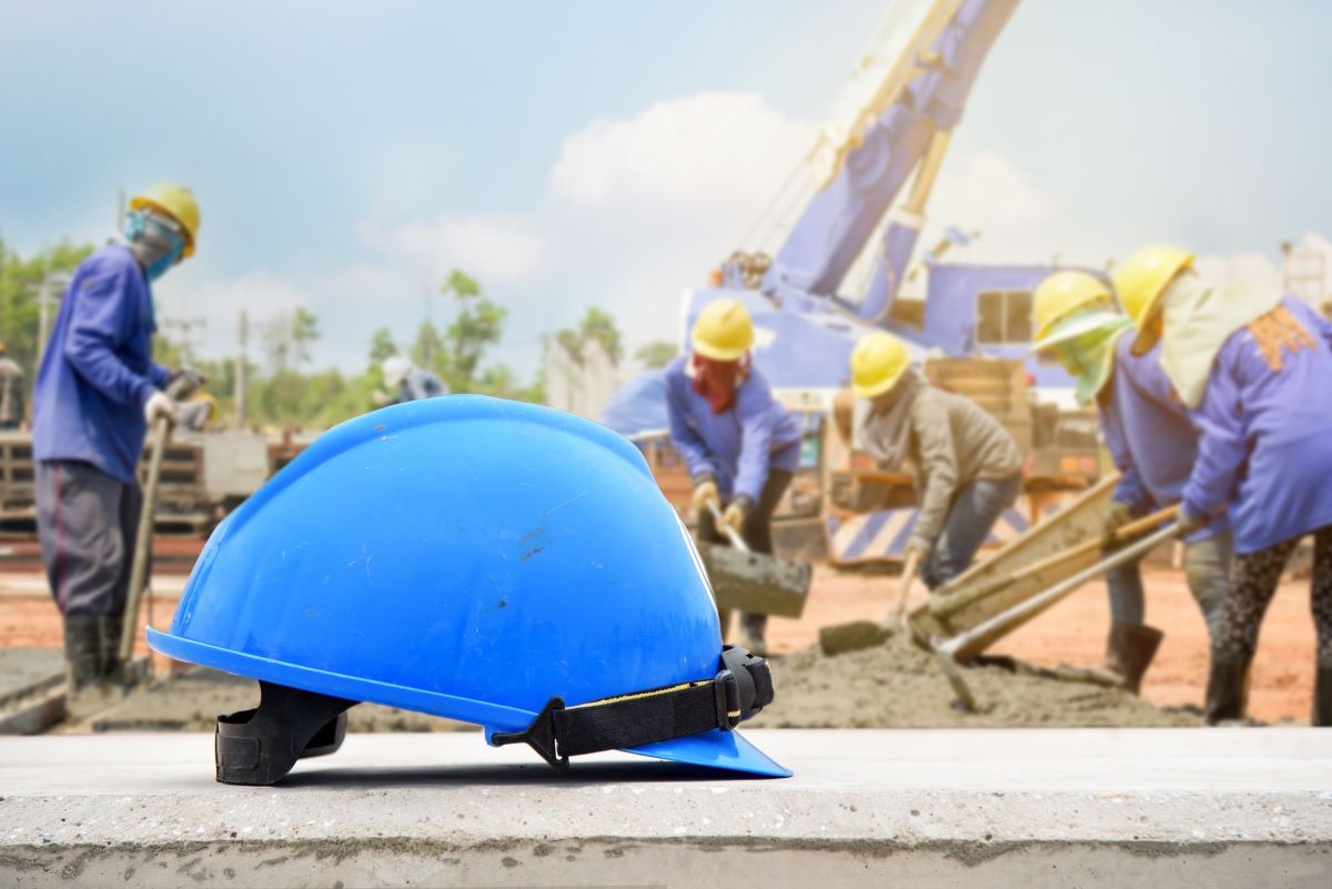 hard hat with construction in the background