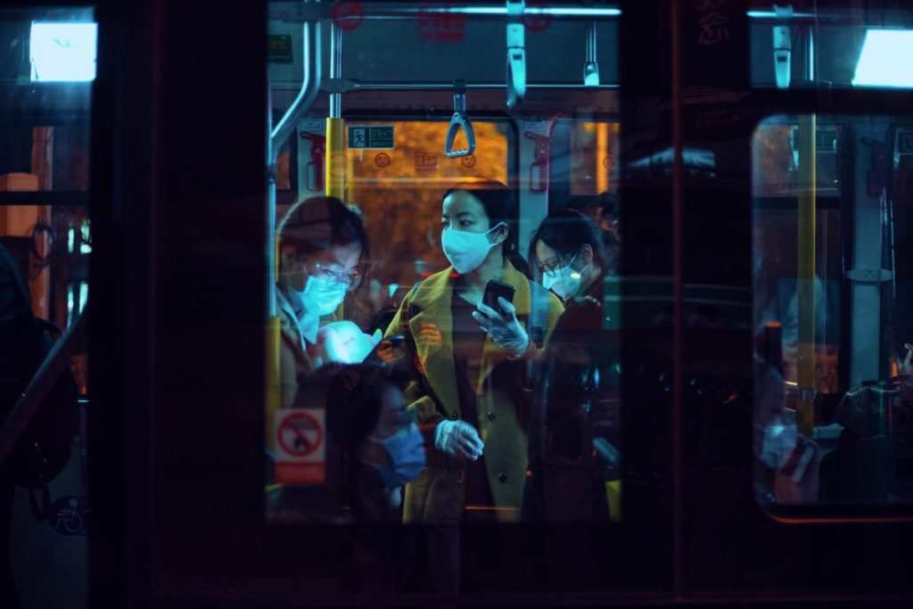 people on the bus wearing facemasks